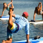SUP Yoga instructor and students